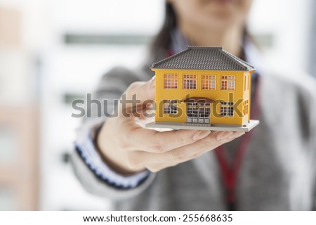 Woman having a housing model - stock photo