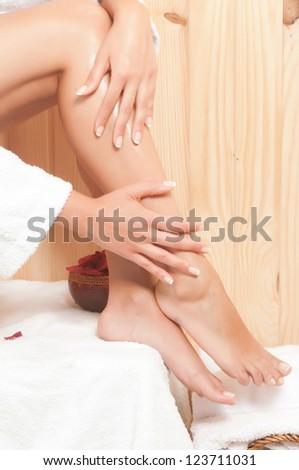 woman having a massage in beautiful legs - stock photo