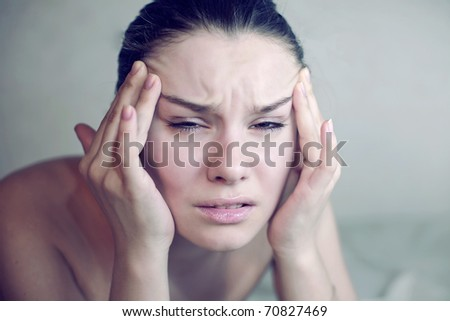 Woman having a migraine. headache holding head in pain - stock photo