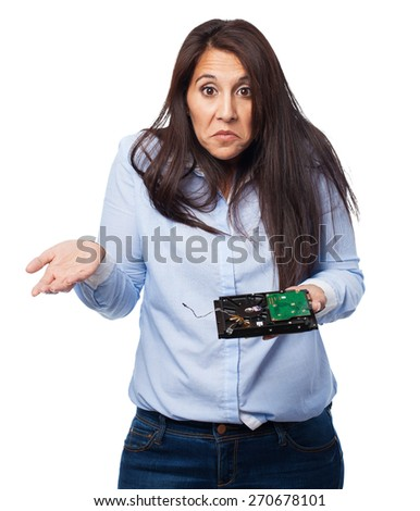 woman having a problem with hard drive - stock photo