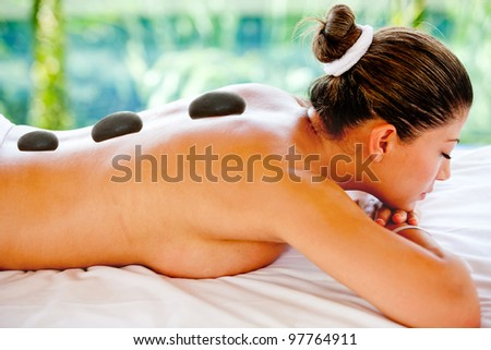 Woman having a relaxing massage at the spa - stock photo