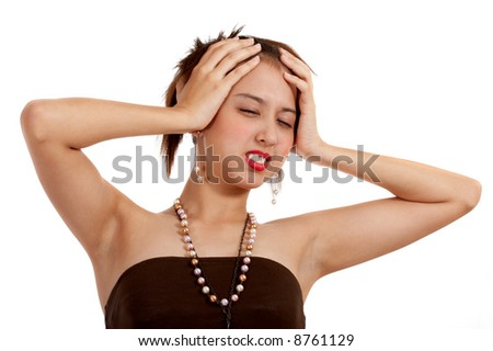 woman having a severe headache holding her head in pain