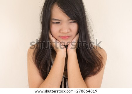 Woman having a toothache. - stock photo