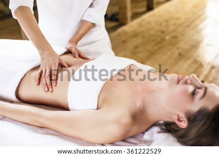 Woman having abdomen massage. - stock photo