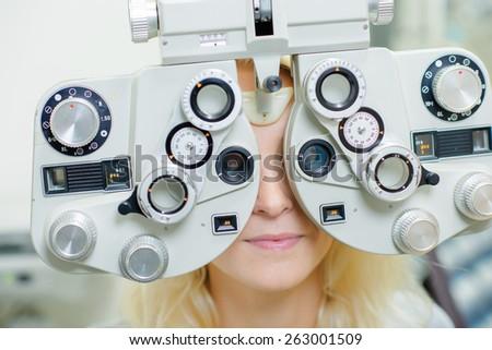 Woman having an eye test - stock photo