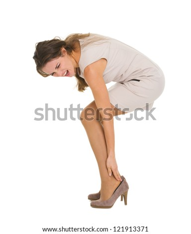 Woman having ankle pain - stock photo
