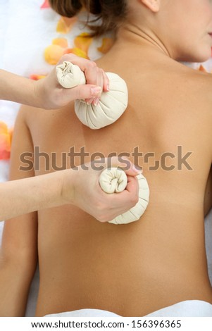 Woman having back massage close up - stock photo