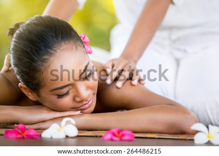 Woman having Balinese massage in the spa salon, outdoor - stock photo
