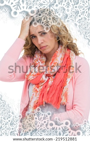 Woman having both headache and belly pain against snowflakes on silver - stock photo