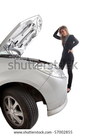 Woman having car trouble with an opened hood - isolated over a white - stock photo