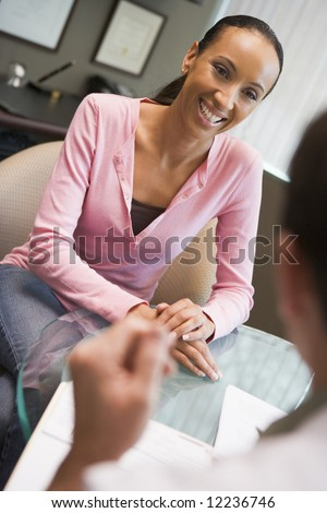 Woman having consultation with doctor in IVF clinic - stock photo
