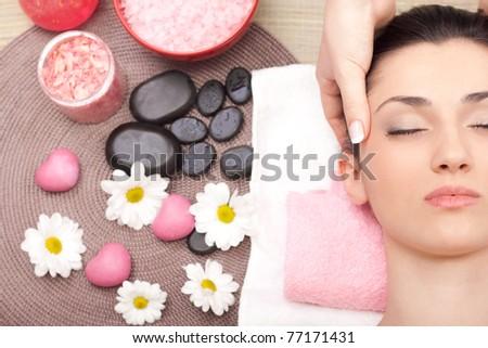 woman having cosmetic massage, close up - stock photo