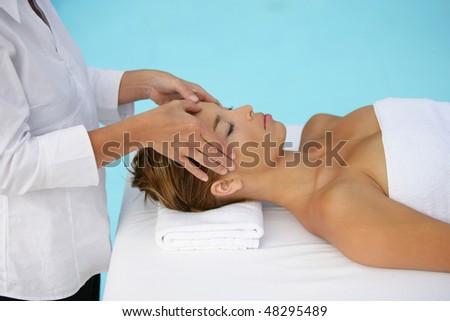 Woman having face massage - stock photo