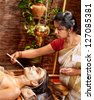 Woman having facial mask at ayurveda spa. - stock photo