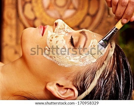 Woman having facial mask at ayurveda spa. - stock photo