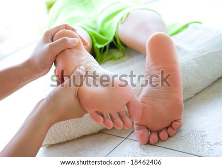 Woman having foot reflexology - stock photo