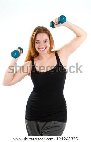 Woman having fun exercising and working out using dumbbells.