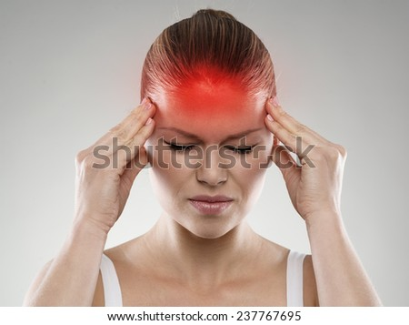 Woman having headache or dizziness problem. Health care and treatment concept. - stock photo