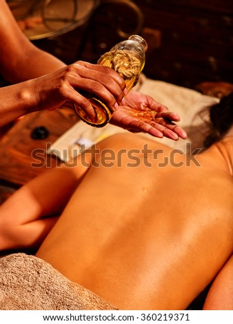Woman having massage with pouch. - stock photo