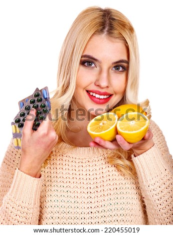 Woman having remedy and lemon. Isolated. - stock photo