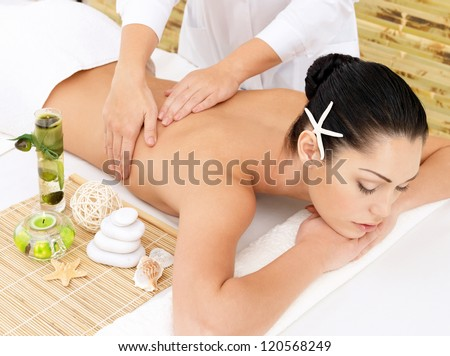 Woman having therapy massage of back in the spa salon. Beauty treatment concept. - stock photo