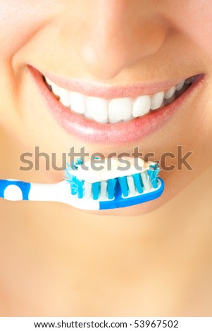Woman healthy teeth closeup brushing concept - stock photo