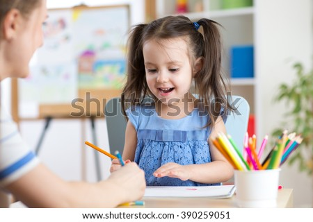 Woman helping her daughter with homework - stock photo