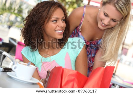 Woman helping her friend - stock photo