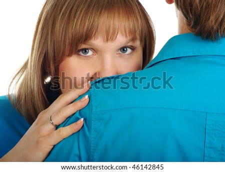 Woman hides behind her man shoulder, isolated on white
