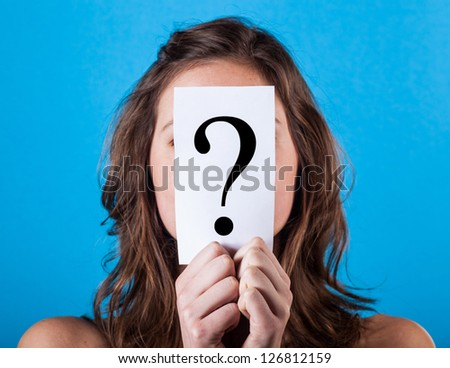 Woman Hiding Behind a Question Mark - stock photo