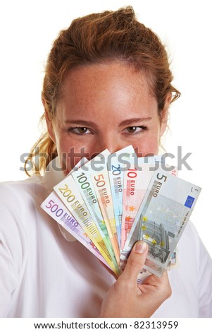Woman hiding behind fan of Euro money bills - stock photo