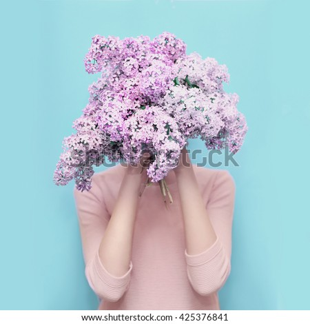 http://thumb7.shutterstock.com/display_pic_with_logo/2273876/425376841/stock-photo-woman-hiding-head-in-bouquet-lilac-flowers-over-colorful-blue-background-425376841.jpg