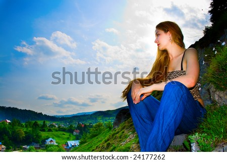 Woman high up looking over mountain panorama - stock photo