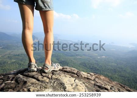 woman hiker enjoy the view at mountain peak  - stock photo