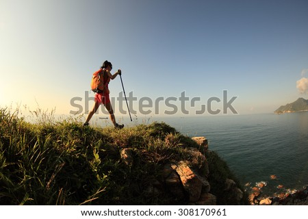 woman hiker  hiking on seaside mountain  trail