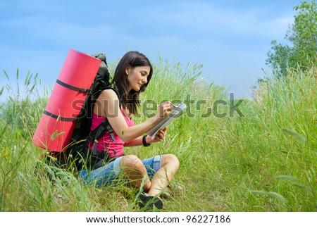 woman hiker in meadow grass - stock photo