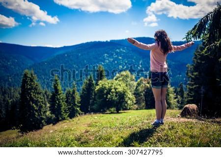 Woman Hiker in Romania enjoying the view - stock photo