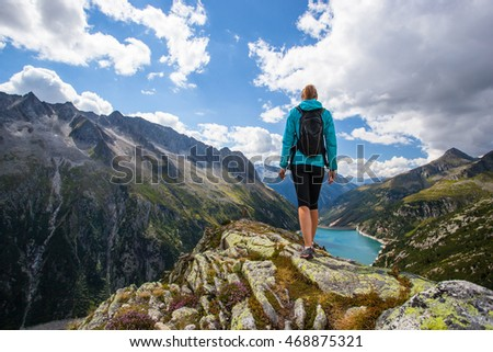 Woman hiker on a top of a mountain during hiking track in Austria