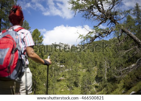 Woman hiker on the way to mountain peak, on sunny day, against clear blue sky, selective focus, space for text