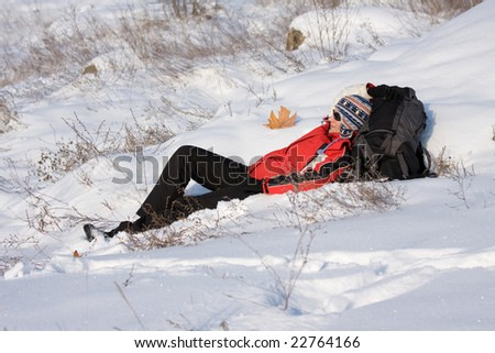 woman hiker resting on the snow