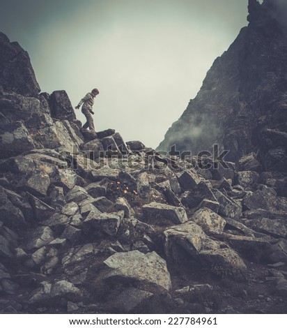 Woman hiker walking in a mountains  - stock photo