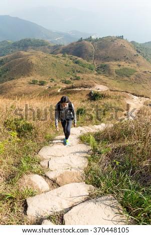 Woman hiking - stock photo