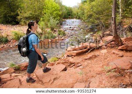 Woman Hiking Along River (Sedona, Arizona) - stock photo
