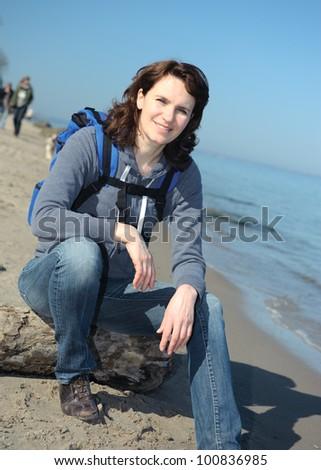 Woman hiking at seacoast in summer - stock photo