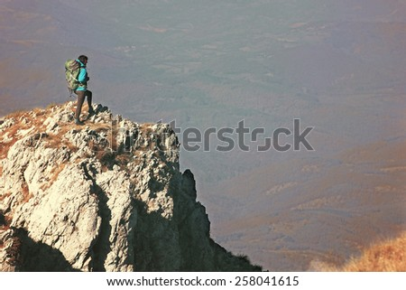 Woman hiking in beautiful mountain, recreation and healthy lifestyle outdoors in nature. Hiker backpacker looking at view.