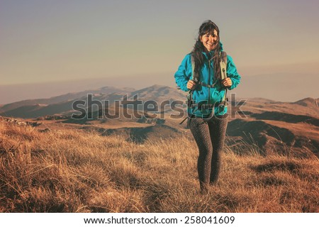 Woman hiking in beautiful nature, recreation and healthy lifestyle outdoors in wild. Hiker backpacker walking on mountain top. - stock photo
