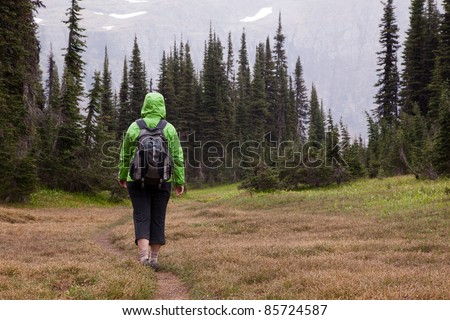 Woman Hiking in Rainy Weather - stock photo
