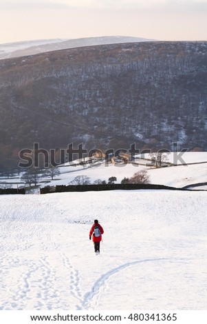 Woman hiking in winter