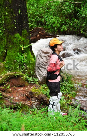 Woman hiking portrait . Fresh and healthy female model - stock photo