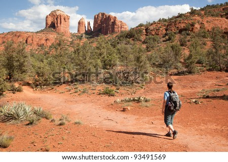 Woman Hiking to Cathedral Rock (Sedona, Arizona) - stock photo